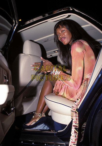 NAOMI CAMPBELL..Ref: 10174..british supermodel, peach gold wrap over around dress..www.capitalpictures.com..sales@capitalpictures.com..©Capital Pictures