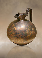 Phrygian bronze trefoil spouted jug from Gordion . Phrygian Collection, 8th century BC - Museum of Anatolian Civilisations Ankara. Turkey. Against an art background