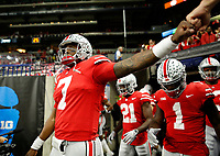 Ohio State Buckeyes quarterback Dwayne Haskins Jr. (7) fist bumps a fan as the team takes the field for warm-ups prior to the Big Ten Championship against the Northwestern Wildcats at Lucas Oil Stadium in Indianapolis on Dec. 1, 2018. [Adam Cairns/Dispatch]