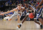 SIOUX FALLS, SD - MARCH 5:  Reed Tellinghuisen #23 of South Dakota State goes after a ball dribbled by Aaron Anderson #2 of Oral Roberts in the 2016 Summit League Tournament. (Photo by Dick Carlson/Inertia)
