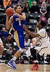 OMAHA, NE - January 10, 2015 -- Skyler Flatten (1) of South Dakota State looks over UNO defender CJ Carter (10) during the first half of their game Saturday evening at the Ralston Arena in Ralston, NE. (Photo By Ty Carlson / DakotaPress)