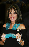 Young and Restless Kate Linder holding TheraPearl product - IT's Ice - It's Hear - It's Relief - Official Daytime Emmy Awards gifting Suite on June 26, 2010 during 37th Annual Daytime Emmy Awards at Las Vegas Hilton, Las Vegas, Nevada, USA. (Photo by Sue Coflin/Max Photos)