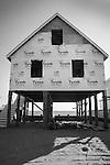 Shorefront, house under construction. Long Island Sound.
