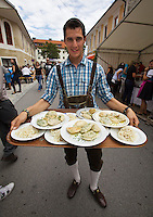 "Kärntnernudelfest (Carinthian Dumplings Festival) in Oberdrauburg 2011. A local in ""Lederhosen"" with Kasnudeln for all his friends."