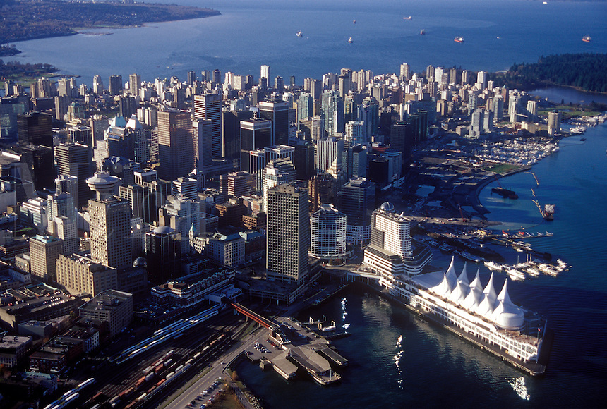 Aerial view of Canada Place Cruise Ship Terminal and Convention Center, with city center and West End.  English Bay in background. Vancouver, BC, Canada