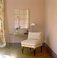 The chair in the corner of this bedroom is an Ilaria Miani design and is upholstered in a hand-printed floral fabric