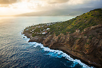 An aerial view right before sunset of waves crashing against the cliffs of Portlock, facing towards Aina Haina, East O'ahu.