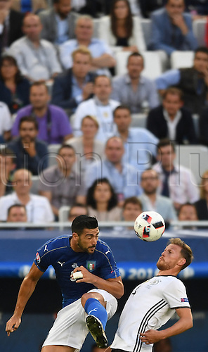 02.07.2016. Bordeaux, France. Germany's Benedikt Hoewedes (R) wins the header from Italy's Graziano Pelle challenge for the ball during the UEFA EURO 2016 quarter final soccer match between Germany and Italy at the Stade de Bordeaux in Bordeaux, France, 02 July 2016.