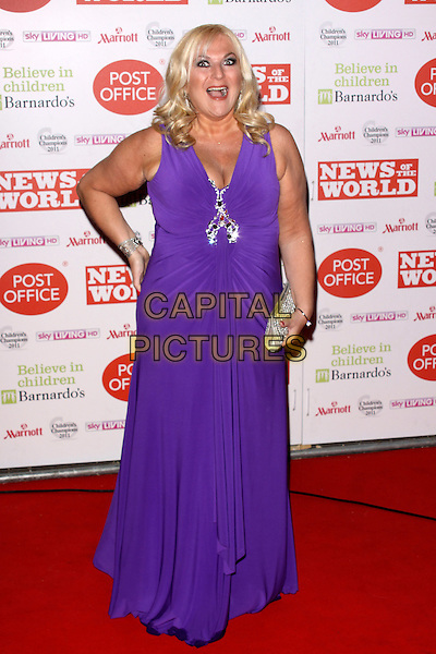 VANESSA FELTZ  .The News Of The World Children's Champion Awards at The Grosvenor House Hotel, London, England. .March 30th, 2011.full length purple maxi dress silver clutch bag mouth open sleeveless hand on hip funny.CAP/AH.©Adam Houghton/Capital Pictures.
