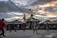 Bajau teenagers play volleyball in the village of Kabalutan in the Togean islands.