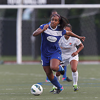 Boston Breakers midfielder Mariah Noguiera (20) works to clear ball. In a National Women's Soccer League (NWSL) match, Boston Breakers (blue) defeated Sky Blue FC (white), 3-2, at Dilboy Stadium on June 30, 2013.