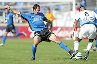 24 October 2004: Brian Mullan of Earthquakes tries to block Wizards' defender Jose Burciaga's ball at Spartan Stadium in San Jose, California.   Earthquakes defeated Wizards, 2-0.  Credit: Michael Pimentel / ISI
