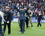 Members of HM armed forces on the pitch at half-time