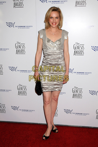 ELANIE HENDRIX .24th Annual Genesis Awards - Arrivals held at the Beverly Hilton Hotel, Beverly Hills, California, USA, 20th March 2010..full length black silver ruched crushed crinkled dress clutch bag black peep toe shoes metallic shiny .CAP/ADM/BP.©Byron Purvis/AdMedia/Capital Pictures.