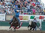 Healer Wyatt Cox competes in the Team Roping event during the Reno Rodeo on Sunday, June 23, 2019.