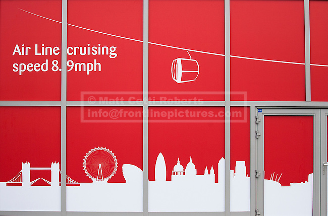 28/06/2012. LONDON, UK. A sign for the Greenwich Peninsula Emirates Air-Line terminal is seen in East London today (28/06/12) at the launch of London's first cable car system. The new cable car system, running across the River Thames between the Greenwich Peninsula and the Royal Docks in East London, was today opened to the public, despite fears that it would not be ready in time for the London 2012 Olympics. Photo credit: Matt Cetti-Roberts