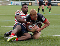 Daniel Harrison dives over for a try for London during the Kingstone Press Championship game between London Broncos and Oldham Roughyeds at Ealing Trailfinders, Ealing, on Sun June 19,2016