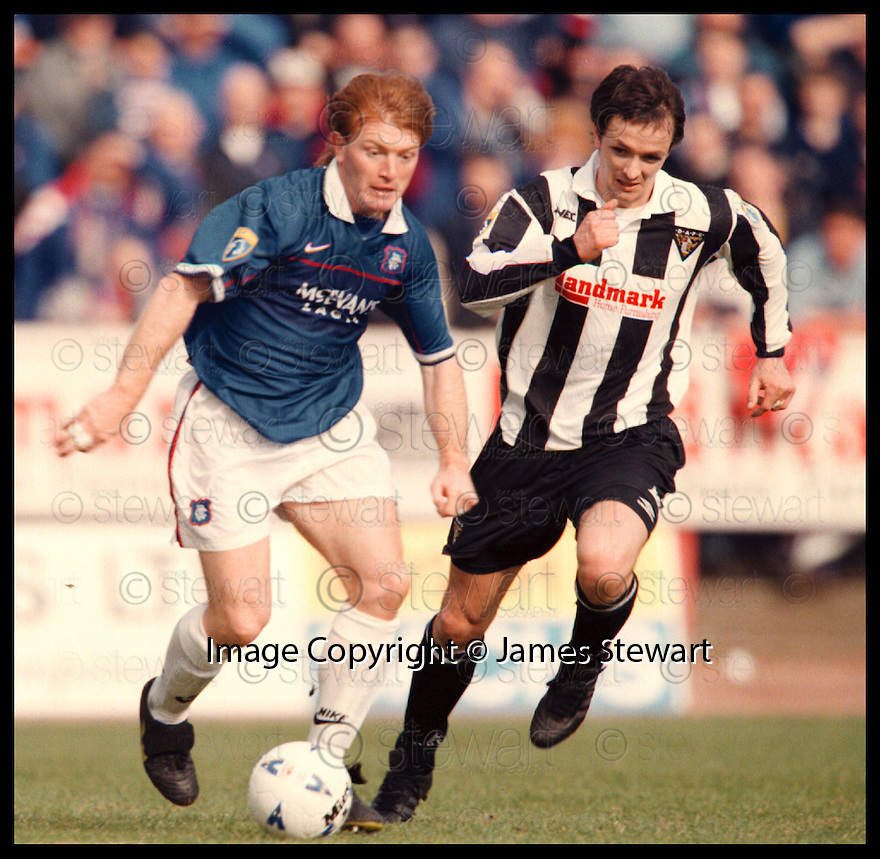 28th March 98      Copyright Pic : James Stewart   .Dunfermline v Rangers.STUARTMCCALL GETS AWAY FROM GERRY BRITTON.......Payments to :-.James Stewart Photo Agency, Stewart House, Stewart Road, Falkirk. FK2 7AS      Vat Reg No. 607 6932 25.Office : 01324 630007        Mobile : 0421 416997.If you require further information then contact Jim Stewart on any of the numbers above.........