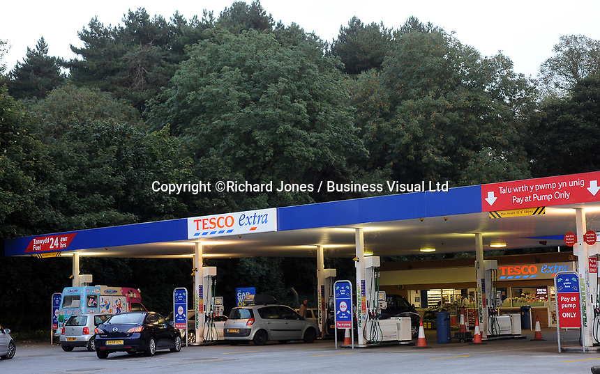 Tesco Petrol station at night in Cardiff, Wales, UK
