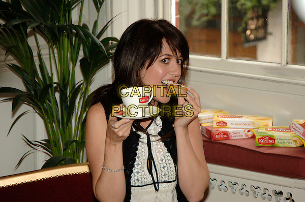 SHEREE MURPHY.Mr Kipling National Gossip Survey press launch & photocall, 68 Dean Street, London, UK..March 14th, 2006.Ref: PL.half length mug sweet food cup saucer tea eating.www.capitalpictures.com.sales@capitalpictures.com.©Capital Pictures