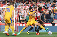 Sam Morsy of Wigan Athletic tackles Brentford's Romaine Sawyers during Brentford vs Wigan Athletic, Sky Bet EFL Championship Football at Griffin Park on 15th September 2018