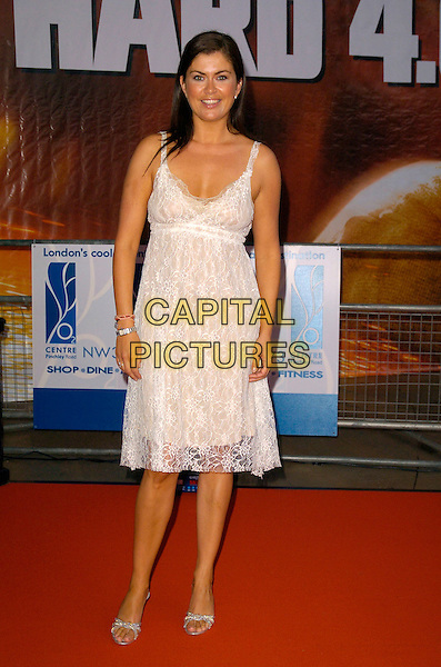 "AMANDA LAMB.Attending a charity screening of ""Die Hard 4.0"" at the 02 Centre, Swiss Cottage, London, England, July 2nd 2007..full length cream white dress lace sheer .CAP/CAN.©Can Nguyen/Capital Pictures"