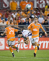 Pachuca FC forward Bruno Marioni (9) falls forward over Houston Dynamo defender Wade Barrett (24) as Houston Dynamo midfielder Geoff Cameron (20) gives chase.. Houston Dynamo defeated Pachuca FC 2-0 during the semifinals of the Superliga 2008 tournament at Robertson Stadium in Houston, TX on July 29, 2008.
