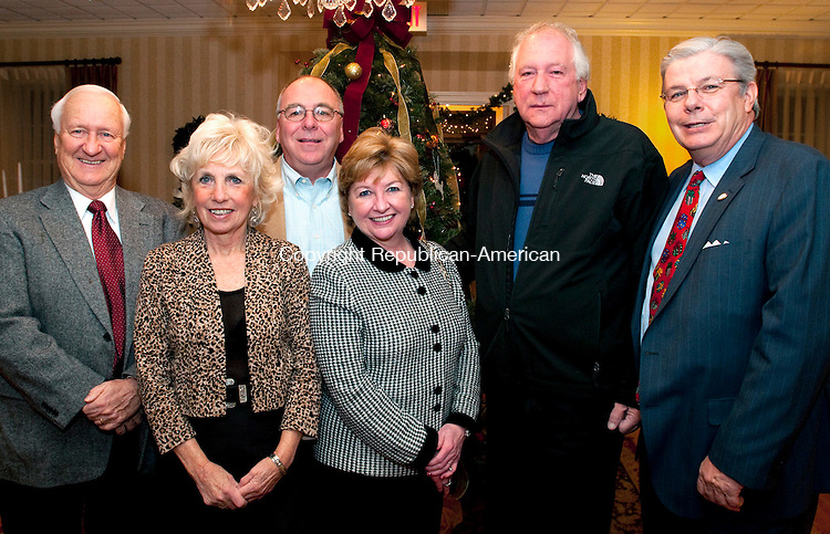 WATERBURY, CT, 09 DECEMBER 2010-110910JS06-Former Waterbury Youth Service board member Sam Leisring, left, with curent board members, Janice Paul, Michael Maglione, Tara Gryga, Domenic Jannetty and John W. Betkoski III at the Waterbury Youth Service's Santa's Toy Fund 25th Anniversary Cocktail Gathering held at the Country Club of Waterbury.  <br />  Jim Shannon Republican-American