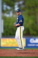 Michigan Wolverines relief pitcher Bryan Pall (6) gets ready to deliver a pitch during the second game of a doubleheader against the Canisius College Golden Griffins on February 20, 2016 at Tradition Field in St. Lucie, Florida.  Michigan defeated Canisius 3-0.  (Mike Janes/Four Seam Images)