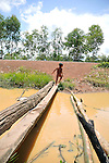 A boy without clothes play in a dirt water in agricultural village that was affected by drought weather.