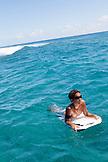 FRENCH POLYNESIA, Moorea. Temakehu, local surfer, boogey boarding.