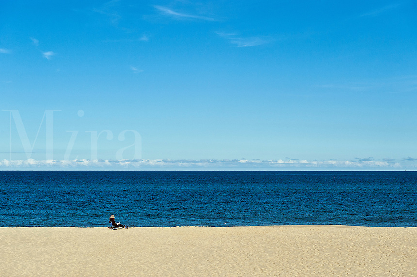 Woman reading on a secluded beach.