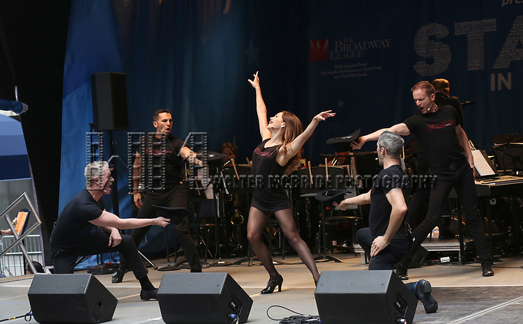 Bianaca Marroquin and the cast of 'Chicago' on stage at United Airlines Presents #StarsInTheAlley free outdoor concert in Shubert Alley on 6/2/2017 in New York City.