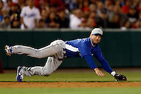Nick Punto #7 of the Los Angeles Dodgers falls to the ground after making a off balance throw against the Los Angeles Angels in both teams final spring training game at Angel Stadium on March 30, 2013 in Anaheim, California. (Larry Goren/Four Seam Images)