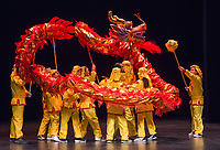 NWA Democrat-Gazette/BEN GOFF @NWABENGOFF<br /> Dancers perform a Chinese dragon dance to open the show Saturday, Feb. 10, 2018, during the Chinese New Year Gala presented by the Chinese Association of Northwest Arkansas at Springdale Har-Ber High. The event celebrated the Year of the Dog with a dinner and a show featuring traditional and contemporary Chinese dance, music, fashion and more.