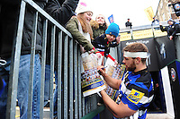 Dave Attwood of Bath Rugby signs autographs after the match. Aviva Premiership match, between Bath Rugby and Saracens on December 3, 2016 at the Recreation Ground in Bath, England. Photo by: Patrick Khachfe / Onside Images