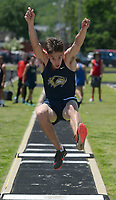 NWA Democrat-Gazette/ANDY SHUPE<br /> Daniel Lestina of Bentonville West leaps Wednesday, May 15, 2019, while competing in the long jump portion of the state decathlon championship at Ramay Junior High School. Visit nwadg.com/photos to see more photographs from the meet.
