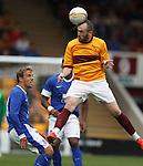James McFadden wins the ball from Phil Neville