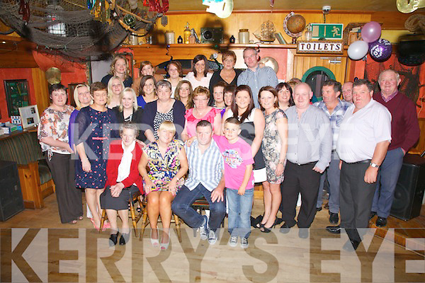 Husband & Wife duo Paula & Mike Brennan (seated front centre) from Portmagee celebrated their 40th birthdays with family and friends at The Bridge Bar & Moorings Restaurant in Portmagee on Saturday night last.