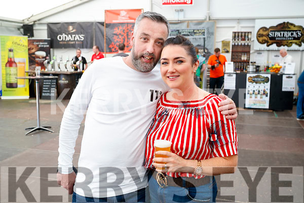 Daniel Moriarty and Claire O'Connor, sampling some of the beers at Killarney Beerfest on Saturday evening last.