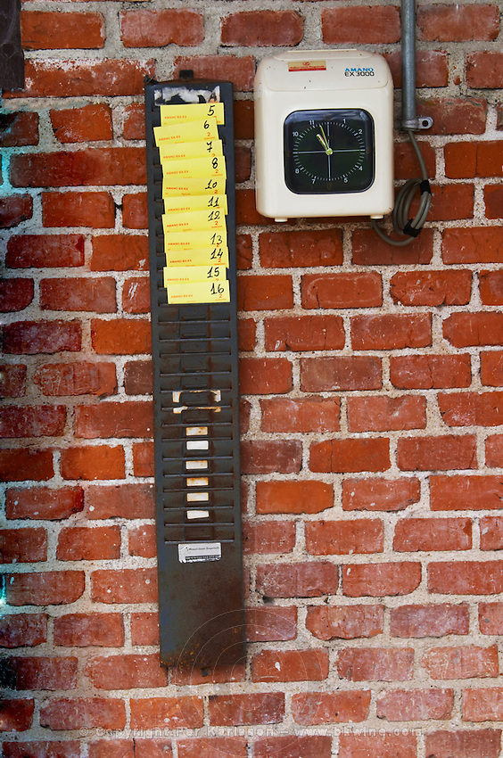 The time clock on the wall of the winery. Everyone seems to be in today. Bodega Bouza Winery, Canelones, Montevideo, Uruguay, South America