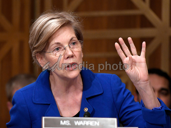 "United States Senator Elizabeth Warren (Democrat of Massachusetts) questions Richard F. Smith, former Chairman and Chief Executive Officer, Equifax, Inc. as he gives testimony before the United States Senate Committee on Banking, Housing, and Urban Affairs as they conduct a hearing entitled, ""An Examination of the Equifax Cybersecurity Breach"" on Capitol Hill in Washington, DC on Tuesday, October 3, 2017. Photo Credit: Ron Sachs/CNP/AdMedia"