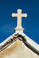Cross on a decaying mausoleum, St Tropez, France