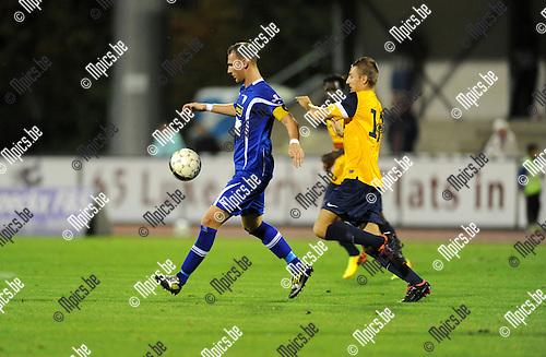 2013-08-15 / Voetbal / seizoen 2013-2014 / KV Turnhout - Woluwe-Zaventem / Aldin Peljto (l. KVT) met Van Ransbeeck<br /><br />Foto: mpics.be