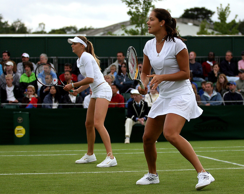 Photo: Paul Thomas..Wimbledon Championships. 28/06/2007...Ana Ivanovic (SRB) and Daniela Hantuchova (SVK) (L) during their double's match against Chia-Jung Chuang and Yung-Jan Chan.