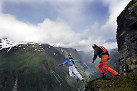 "BASE jumping from a cliff called ""Nebbet"" (the beak) is one of the moste extreme activities performed during Ekstremsportveko. Karina Hollekim in front...Ekstremsportveko, The Extremesport Week, is the worlds largest gathering of adrenalin junkies. In the small town of Voss enthusiasts in a varitety of  extreme sports come togheter every summer to compete and play.© Fredrik Naumann"