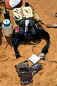 "Zambia. Tourist ""essentials""; binoculars, food rations, rehydration salts, sunscreen cream, water bottle, bird watching book."