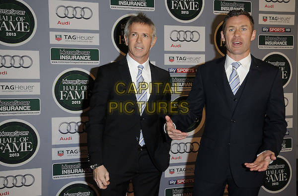 guest & Tom Kristensen.attended the Motor Sport Hall Of Fame induction ceremony, Royal Opera House, Covent Garden, London, England..February 25th, 2013.half length black suit blue stripe tie white shirt hands arms.CAP/CAN.©Can Nguyen/Capital Pictures.
