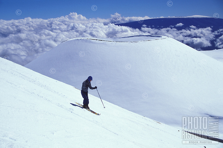 Skiing on a volcanic cinder cone at Mauna Kea, Big Island, Hawaii