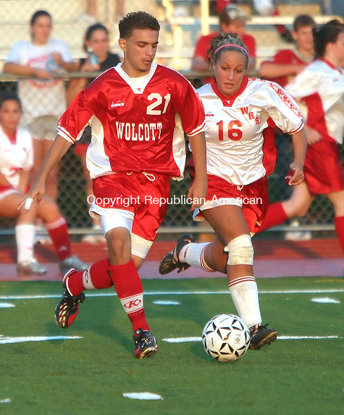 WOLCOTT, CT, 07 SEPTEMBER 2006, 090706BZ03-  Wolcott High School soccer players Matt Rinaldi, 15, gr. 10, and Kelly Olsen, 17,  play an exhibition game on the brand new artificial turf field after it was unveiled to the public Thursday.<br />  Jamison C. Bazinet Republican-American